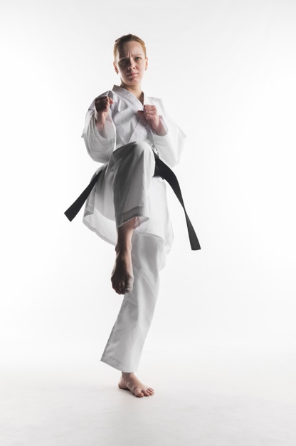 motivated-karate-woman-kicking-front-view_23-2148446162